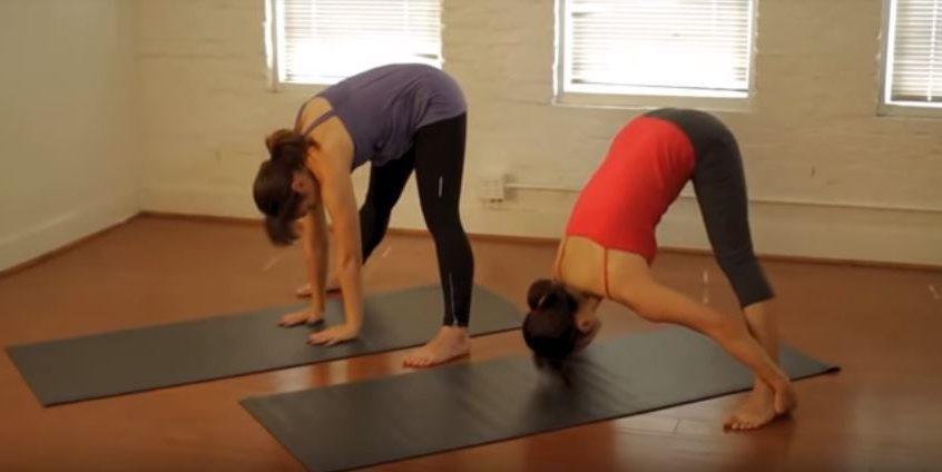 Standing separate leg stretching pose