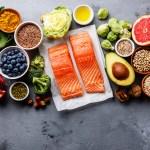 Healthy food clean eating selection: fish, fruit, vegetable, seeds, superfood, cereals, leaf vegetable