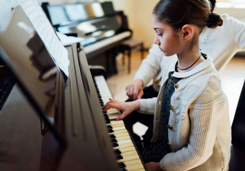 music-teacher-with-the-pupil-at-lesson-piano