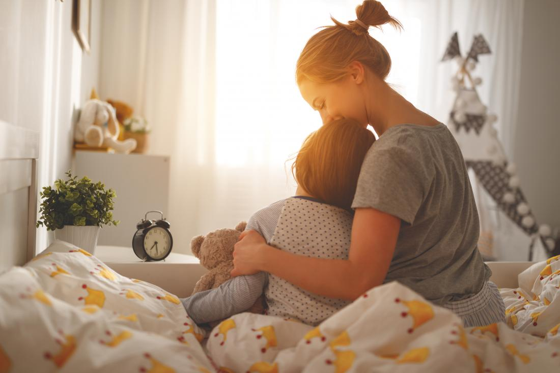 Mother hugging her child and wondering if bipolar is genetic