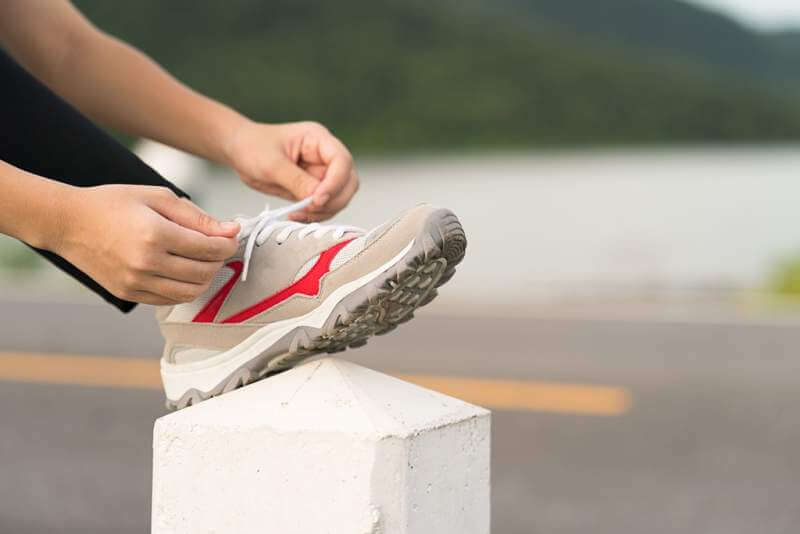 woman-tying-shoelace-his-before-starting-running