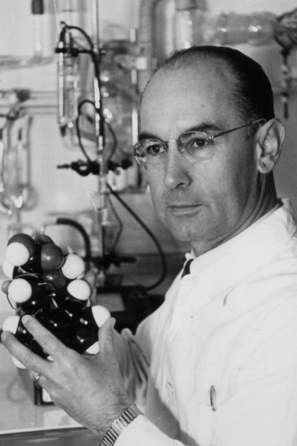 "Albert Hofmann, the ""father"" of LSD, holding a model of the molecule."