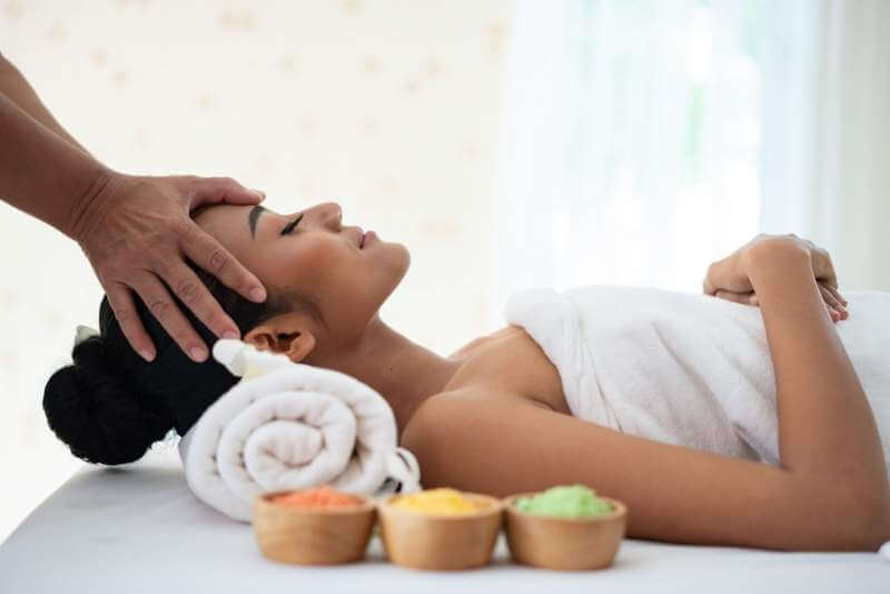 young-woman-enjoying-massage-in-spa-salon