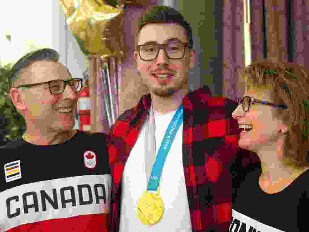 Alex Kopacz, Olympic gold medalist in two-man bobsleigh with his parents Joe and Janet at a Polish club in London, Ont., on April 27, 2018.