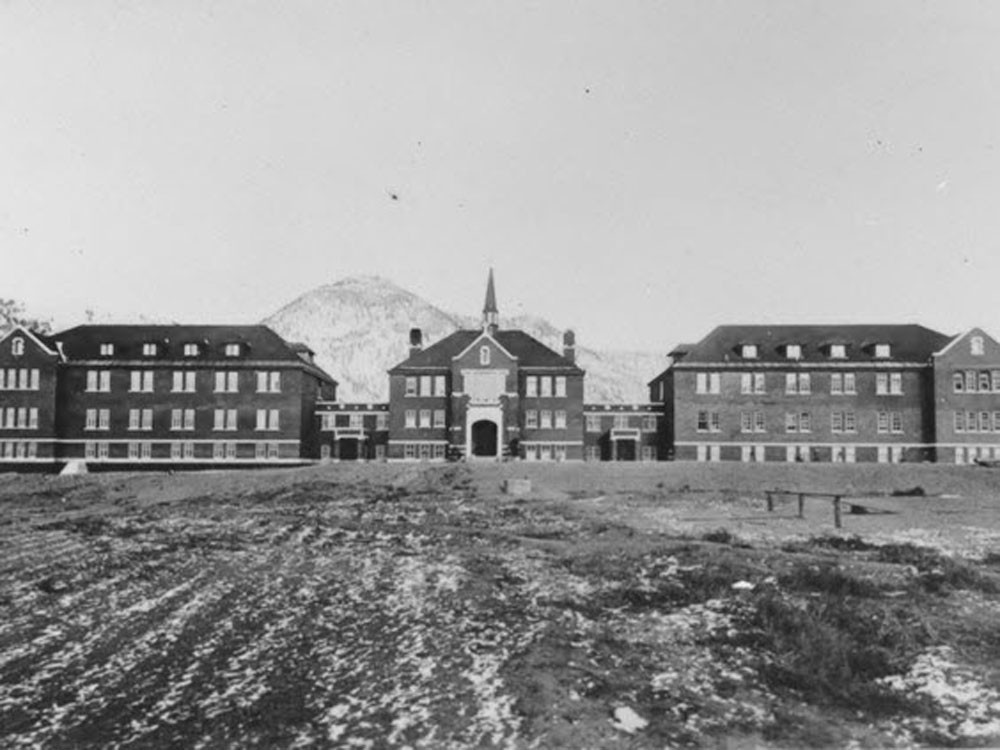 An historic photograph of the Kamloops Indian Residential School, the largest of Canada's 130 residential schools. Ground-penetrating radar has found 215 unmarked graves on the former school property.